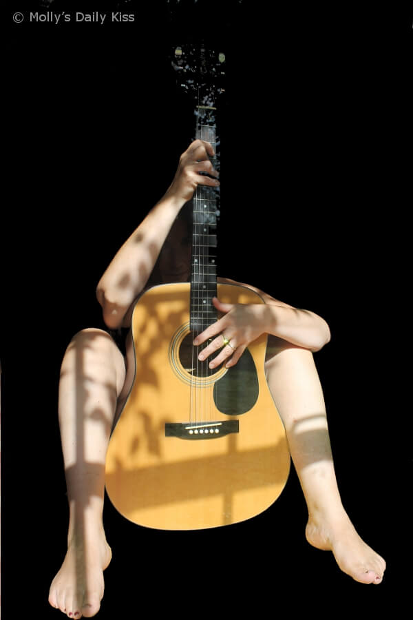Naked Molly with guitar for Food of Love