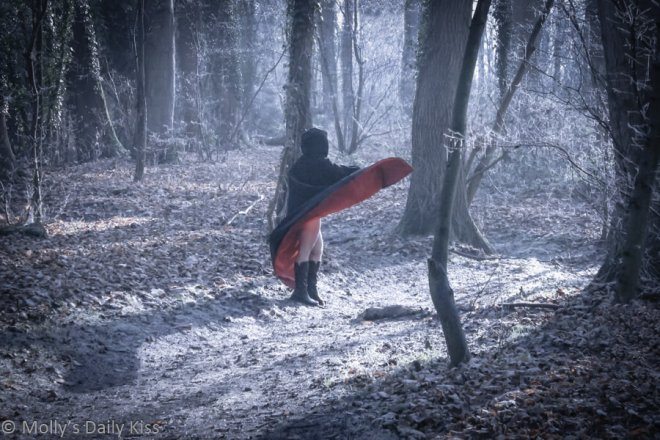Molly in the woods in a cape for party post
