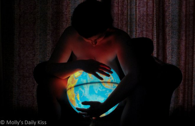 sex blogger holding a globe