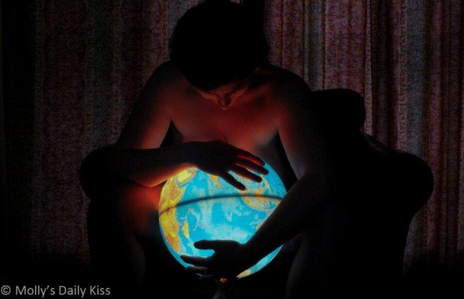 sex blogger holding a globe