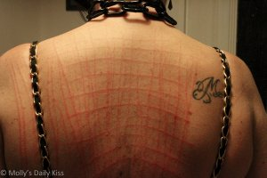 The marks of my knives on her back