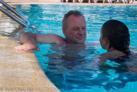 Man and girl in pool for like father like son