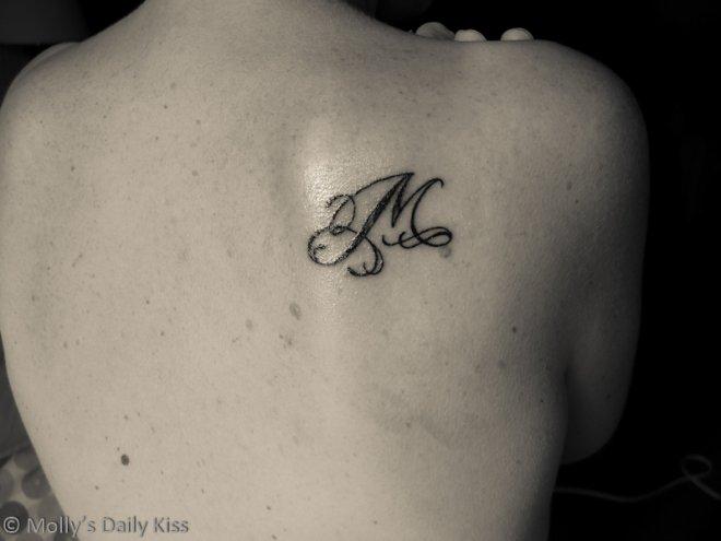 M tattoo