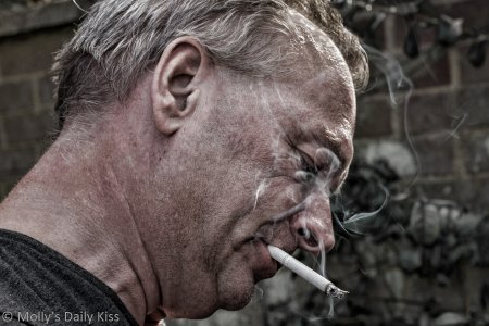 Picture of a man smoking vice