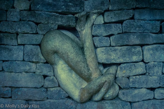 Statue in wall for feet of clay