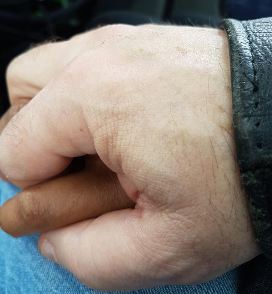 Holding kitten's hand for partings